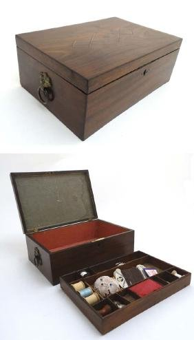 A 19thC mahogany sewing / work box with lift out tray