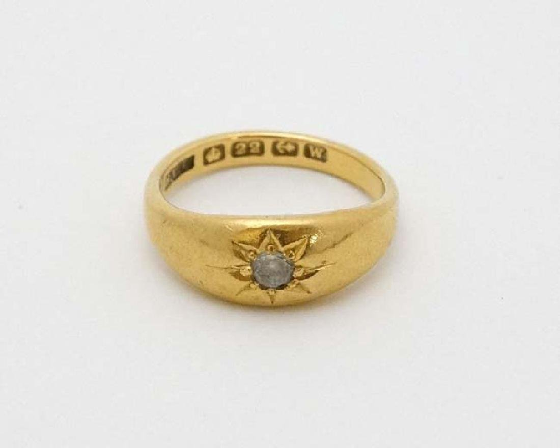 A 22ct gold ring set with white stone hallmarked