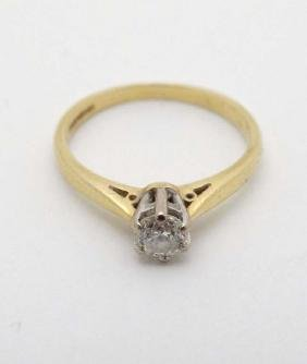 An 18ct gold ring set with diamond solitaire