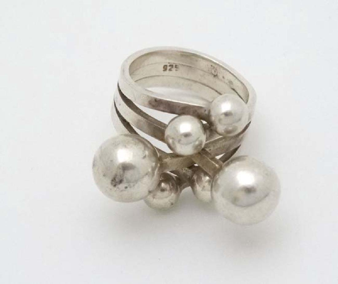 A .925 silver dress ring with spherical ball like