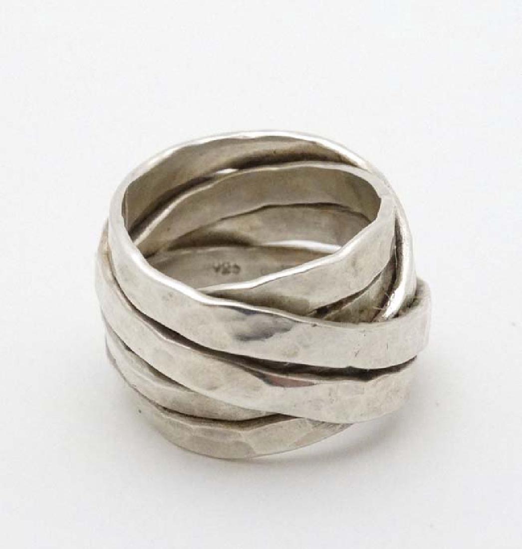 A silver dress ring maker VM