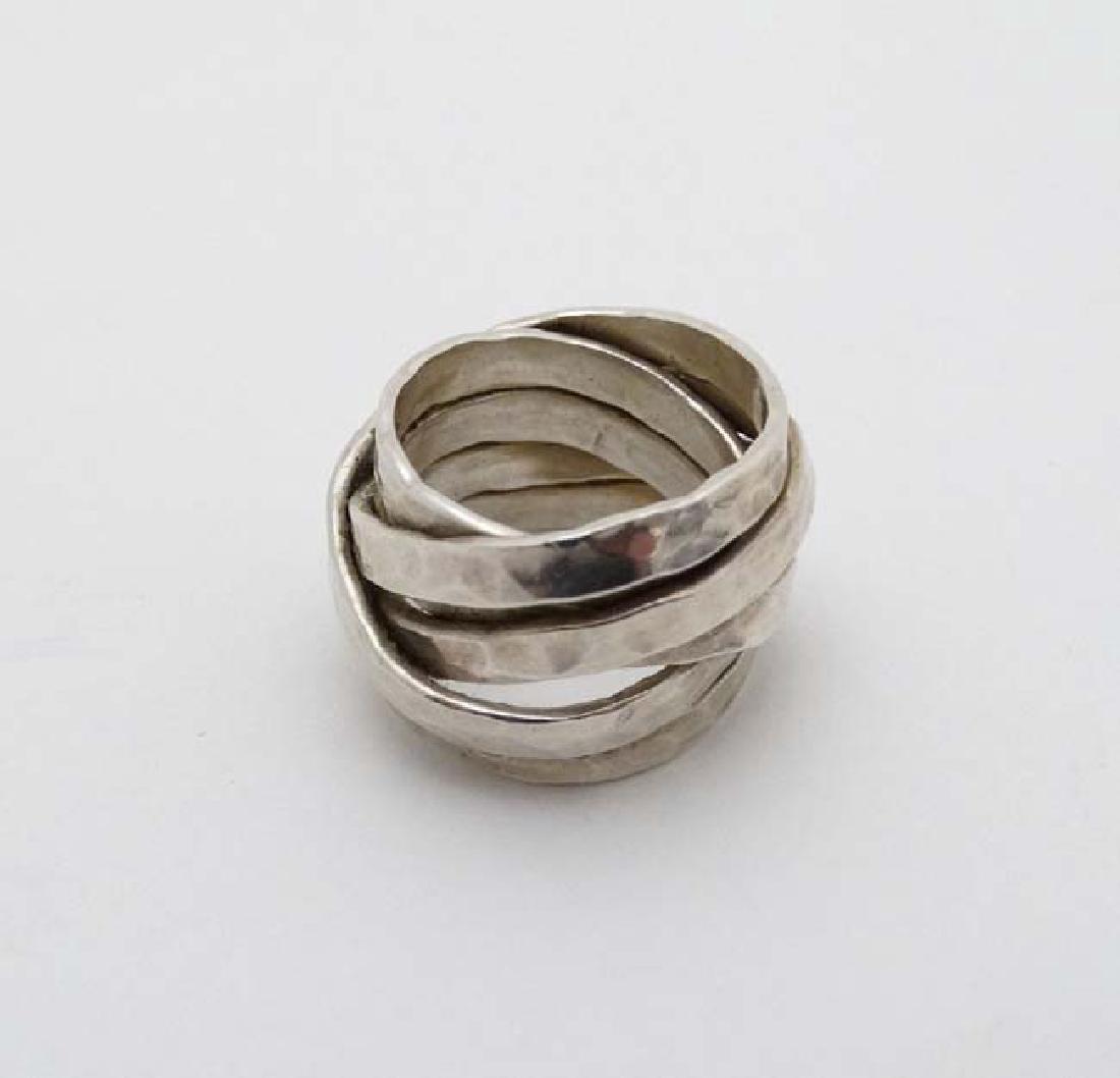 A silver dress ring maker VM - 2