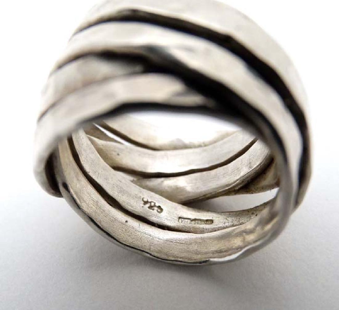 A silver dress ring maker VM - 3