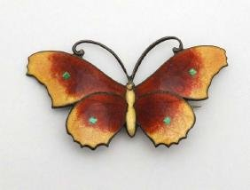 A silver brooch formed as a butterfly with guilloché
