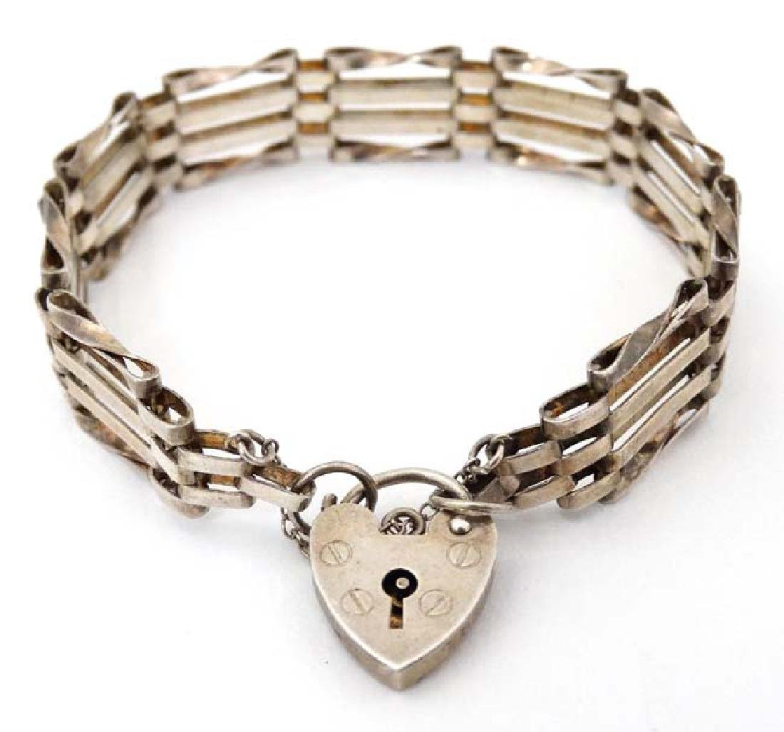 A silver bracelet with padlock clasp hallmarked  London