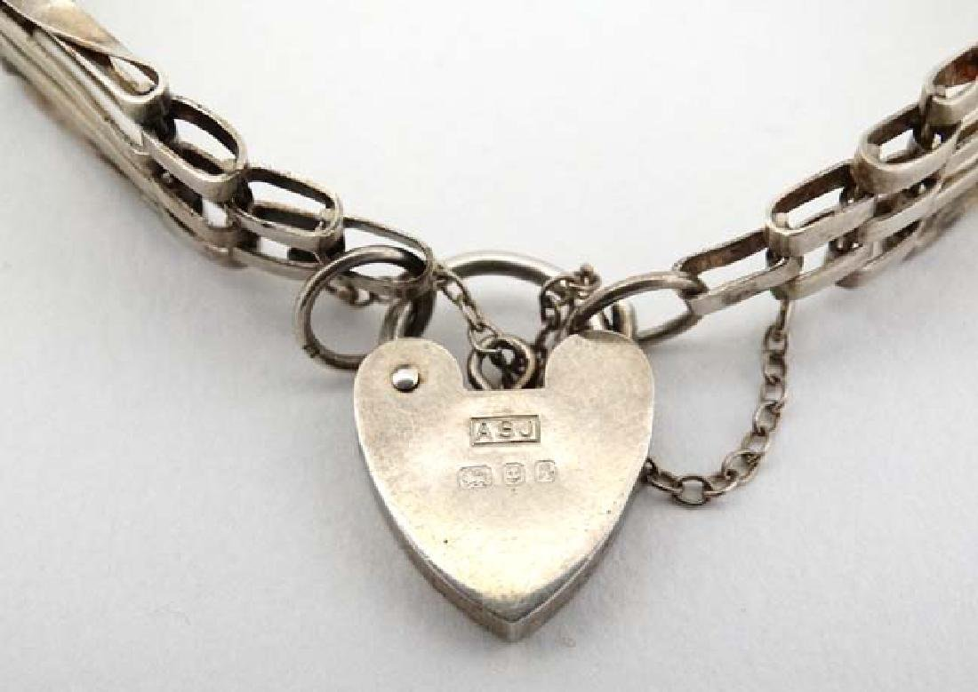 A silver bracelet with padlock clasp hallmarked  London - 2