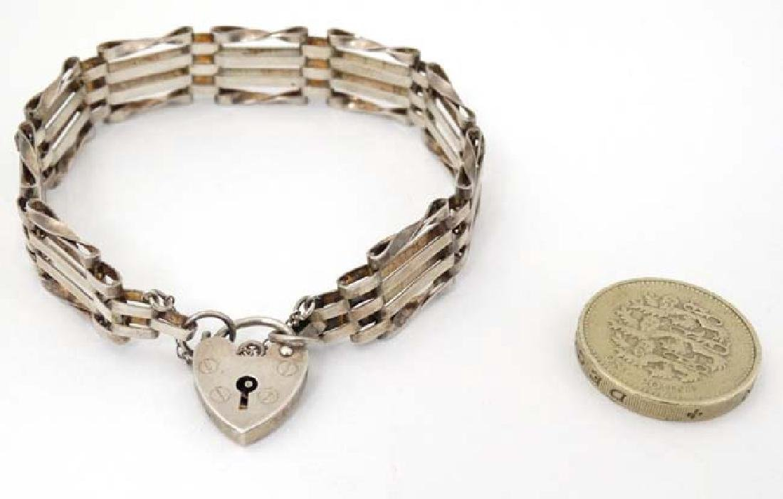 A silver bracelet with padlock clasp hallmarked  London - 3