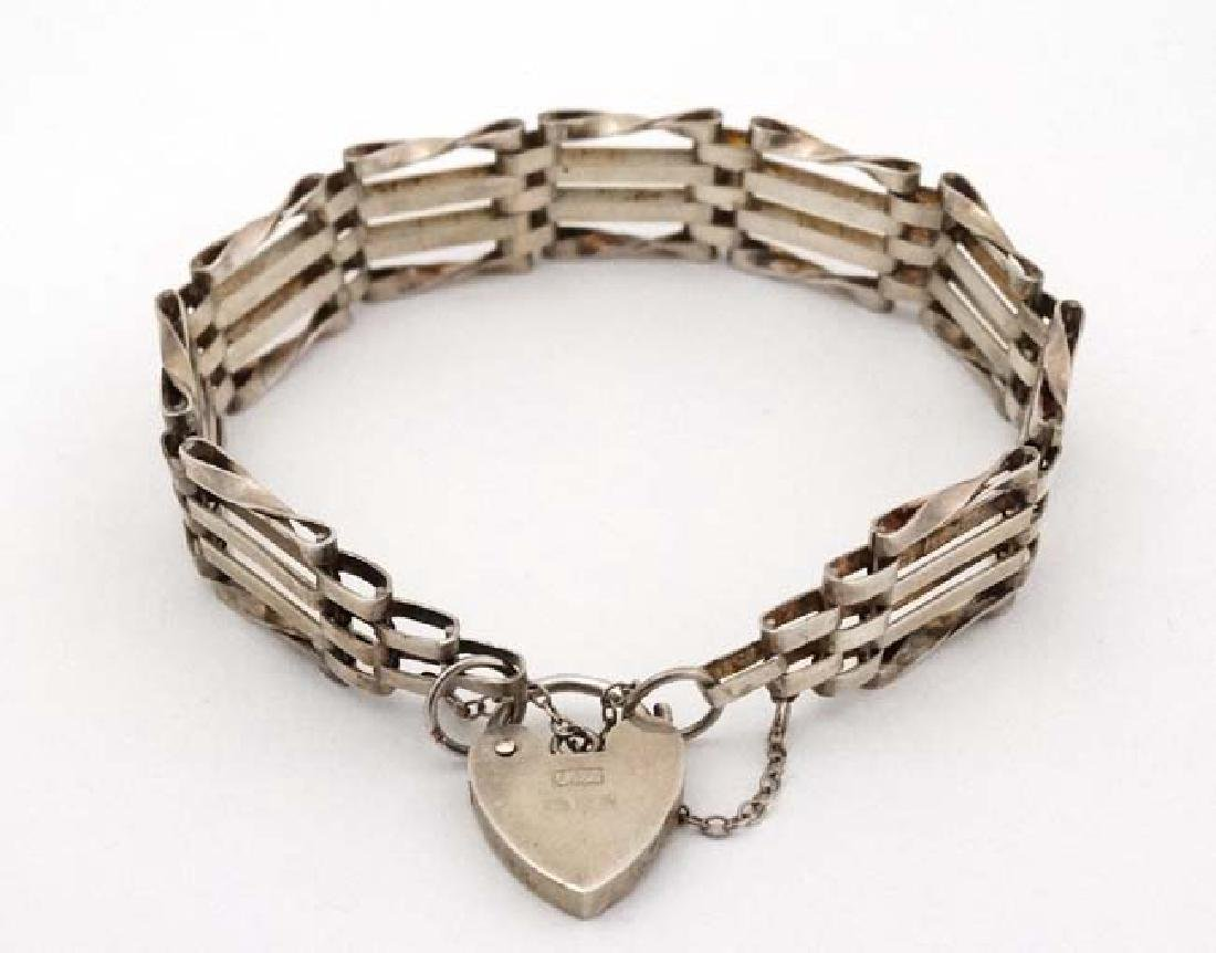 A silver bracelet with padlock clasp hallmarked  London - 4