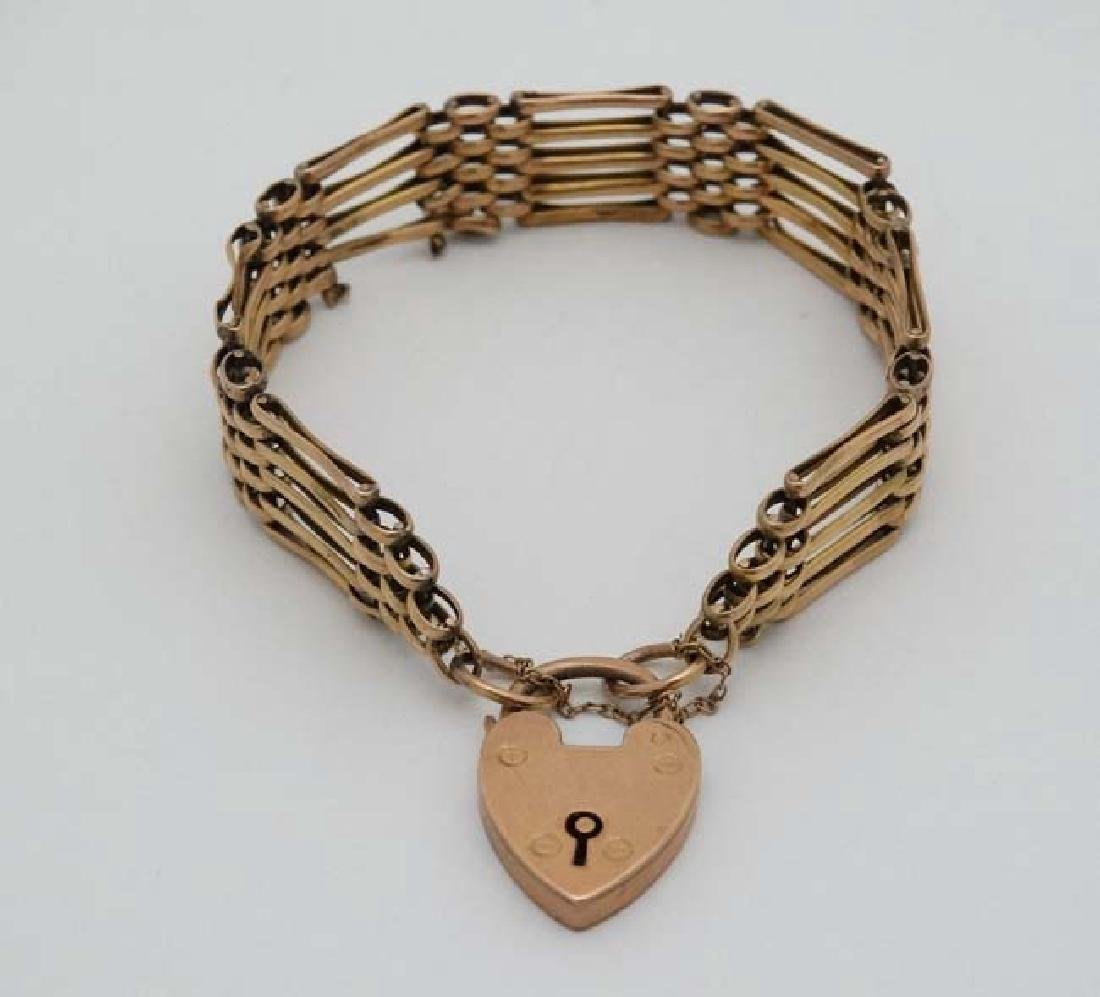 A 9ct gold bracelet with padlock clasp. - 3