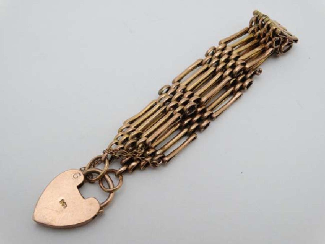 A 9ct gold bracelet with padlock clasp. - 4