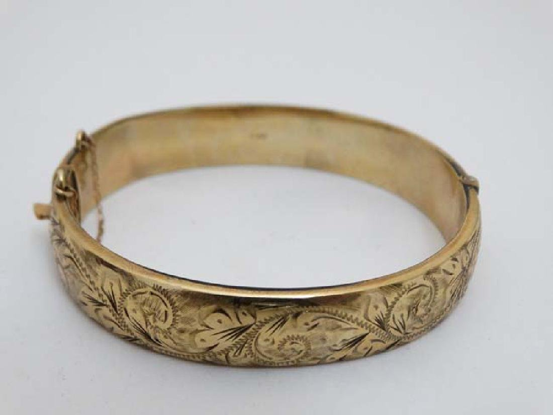 A 9ct gold bracelet of bangle form  with engraved - 2