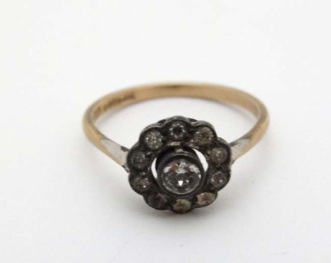 A 9ct gold and silver ring set with white stones
