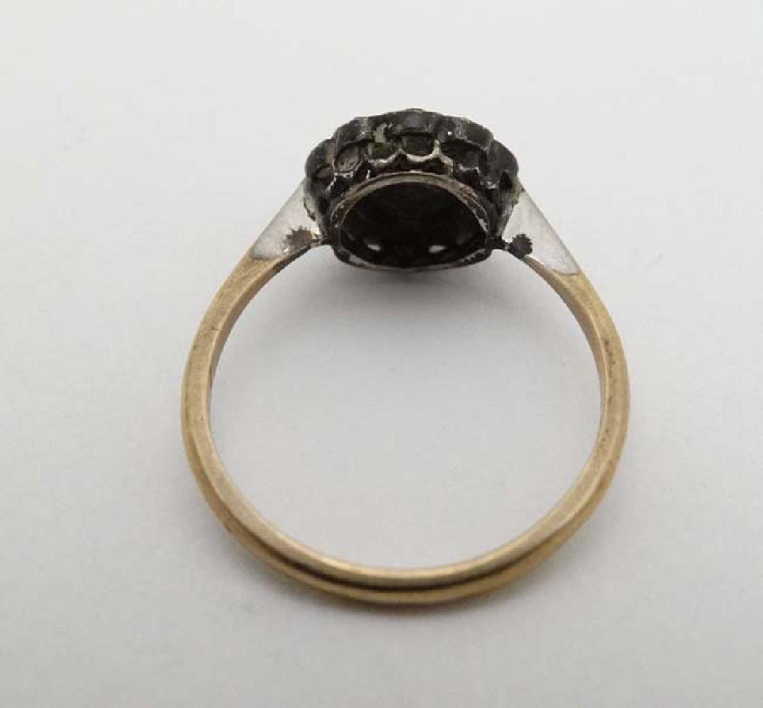 A 9ct gold and silver ring set with white stones - 2