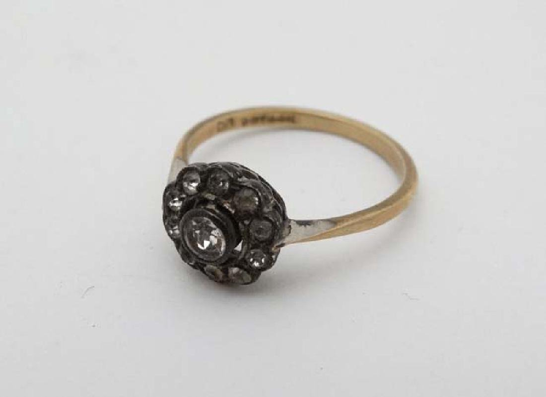 A 9ct gold and silver ring set with white stones - 3
