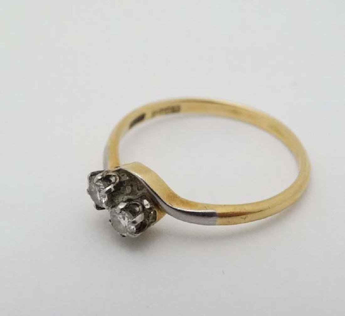 An 18ct ct gold ring set with two diamonds to top - 3