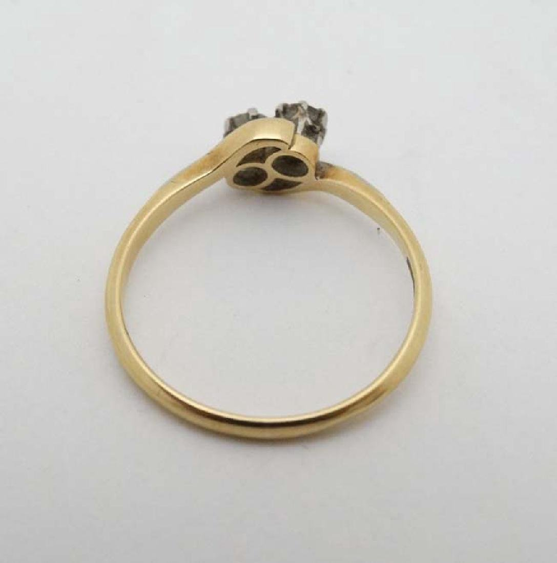 An 18ct ct gold ring set with two diamonds to top - 4