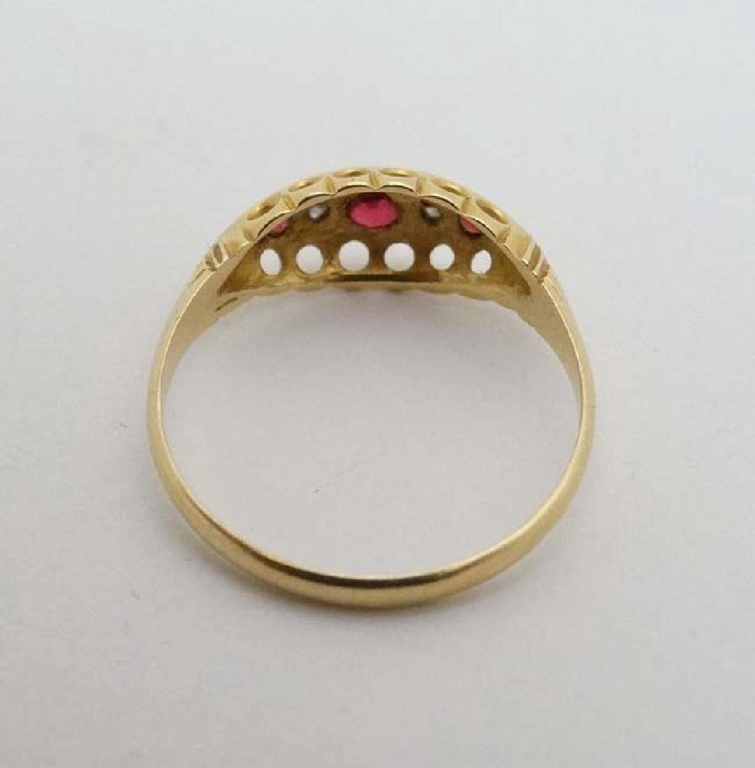 An 18ct gold ring set with diamonds and red stones. - 2