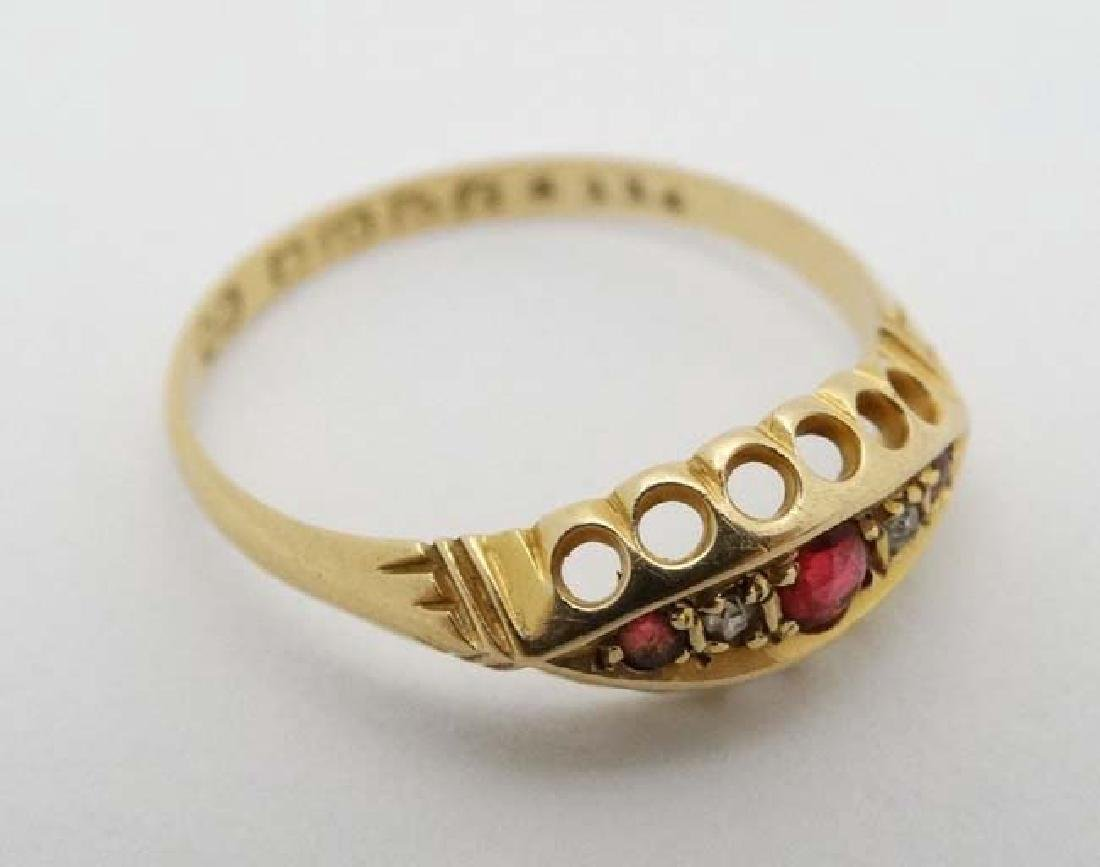 An 18ct gold ring set with diamonds and red stones. - 3