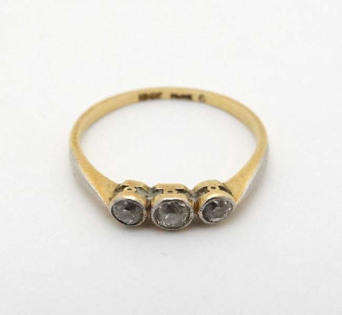 A 18ct gold ring set with trio of diamonds