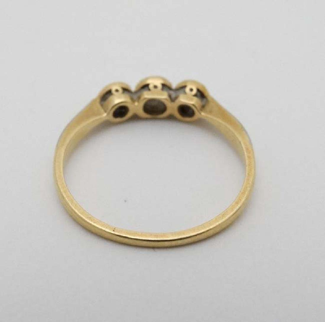 A 18ct gold ring set with trio of diamonds - 3