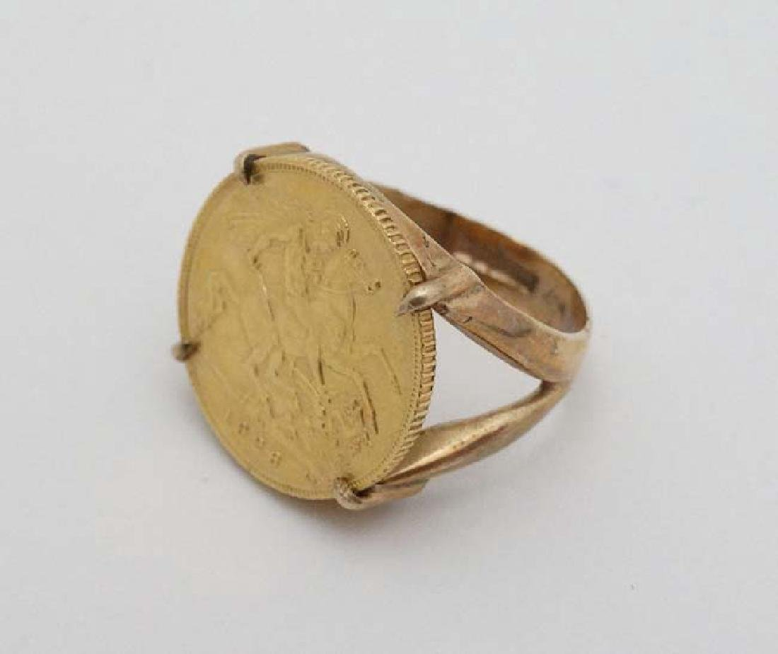 A 9ct gold ring set with half sovereign coin dated