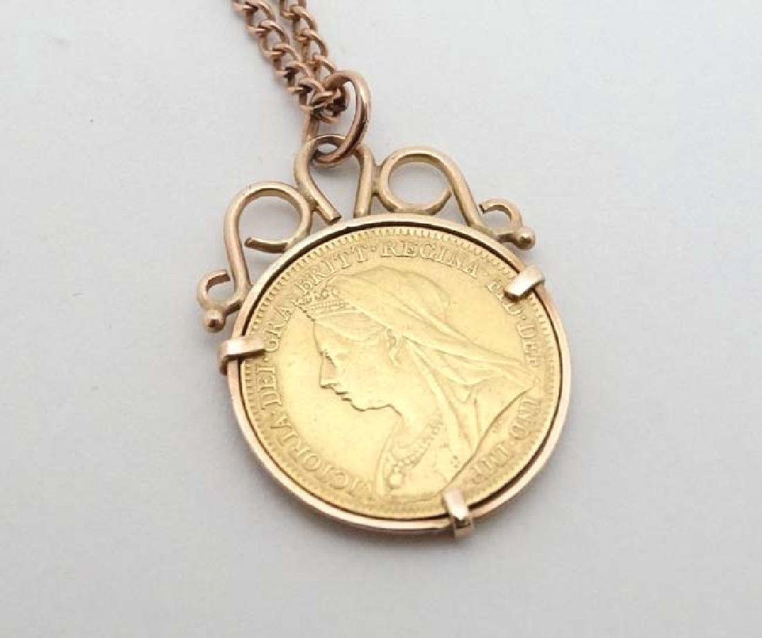 A 9ct pendant set with half sovereign coin dated 1897,