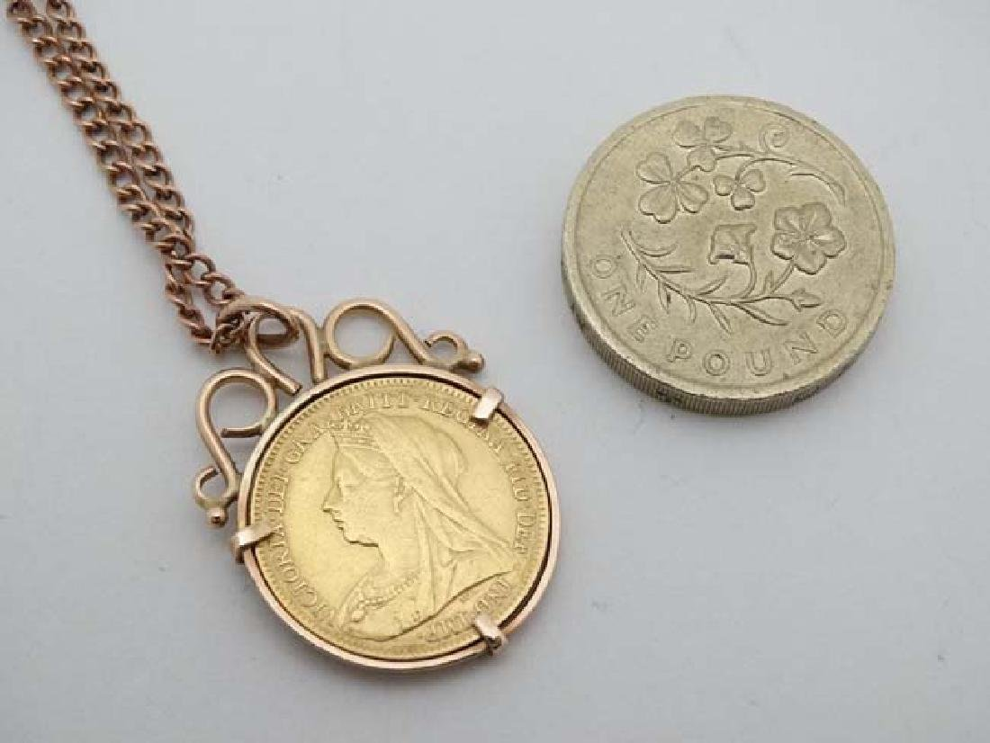A 9ct pendant set with half sovereign coin dated 1897, - 2