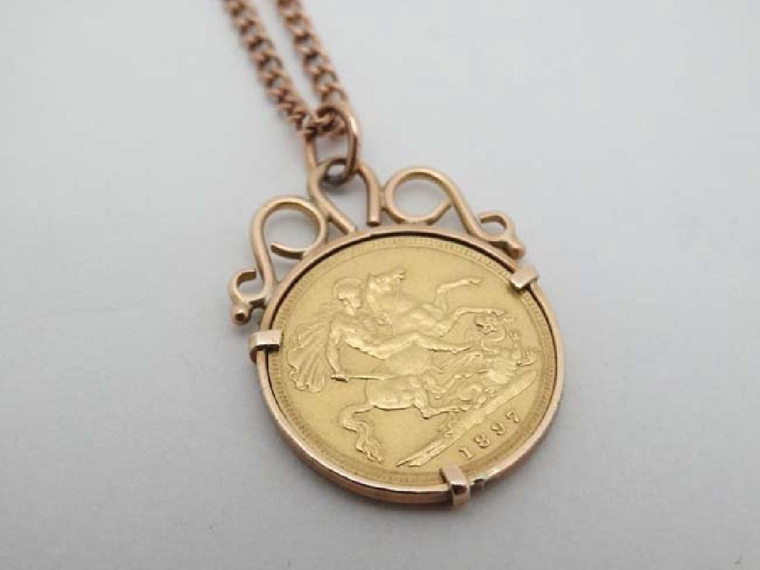 A 9ct pendant set with half sovereign coin dated 1897, - 4