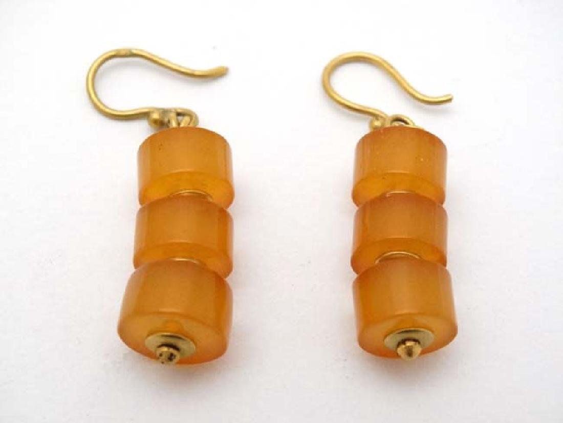 A pair of yellow metal drop earrings set with amber - 2