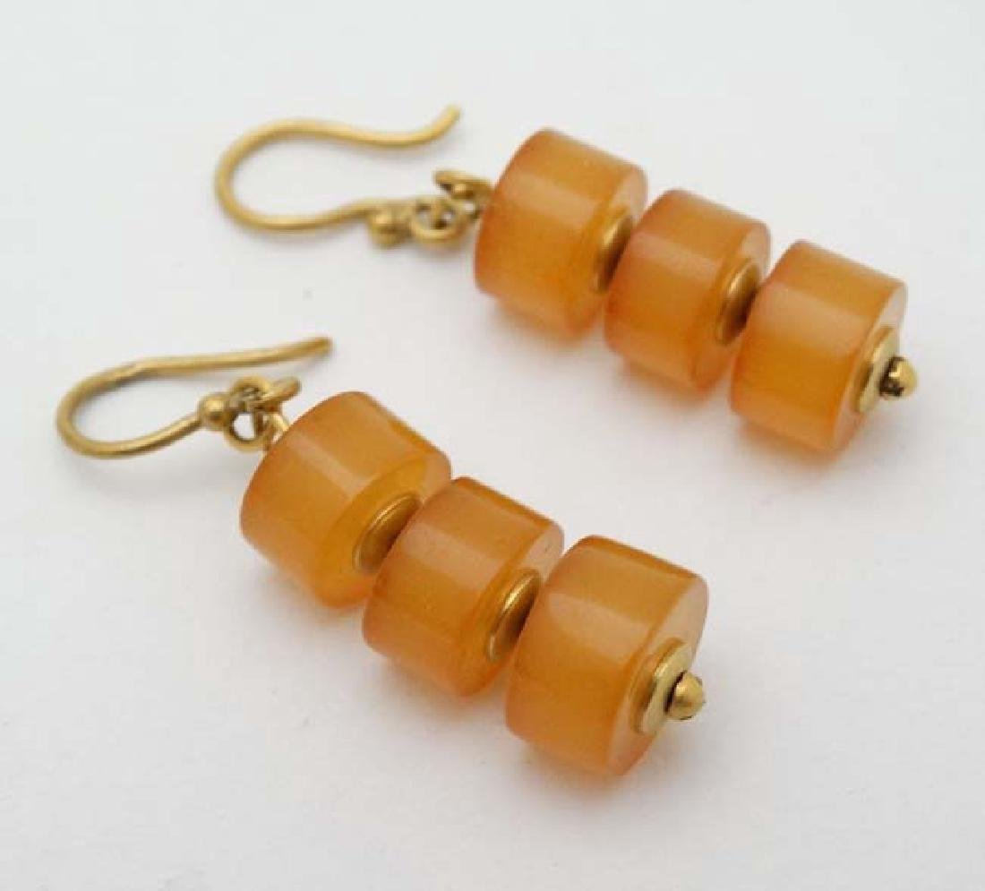 A pair of yellow metal drop earrings set with amber - 3