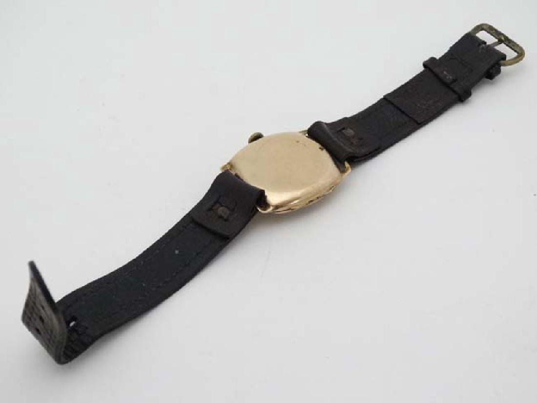 An early .375 Gold cased Gentlemans Wrist Watch : a 15 - 2