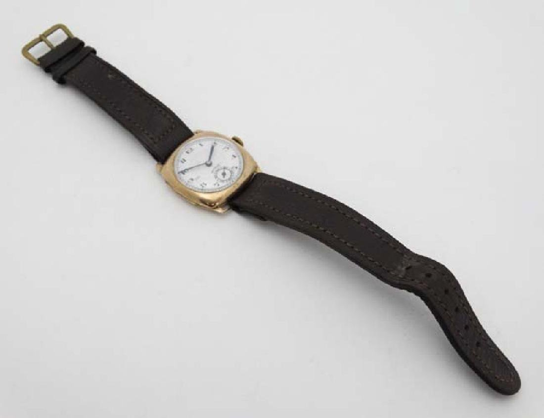 An early .375 Gold cased Gentlemans Wrist Watch : a 15 - 3