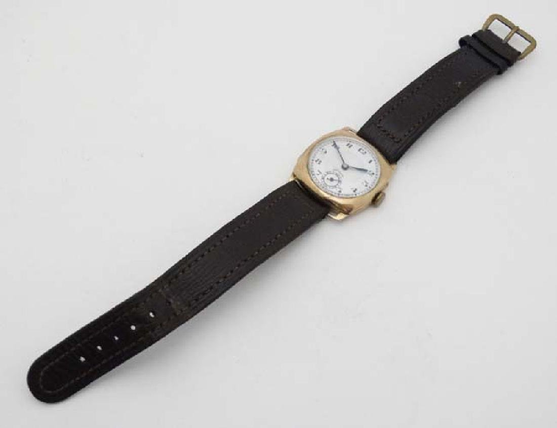 An early .375 Gold cased Gentlemans Wrist Watch : a 15 - 4