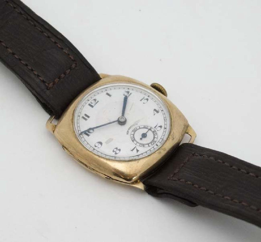 An early .375 Gold cased Gentlemans Wrist Watch : a 15 - 5