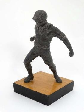 A mid 20thC cast metal model of a footballer? Probably