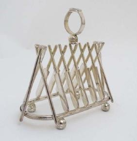 A novelty 6-slice silver plated toast rack, the bars