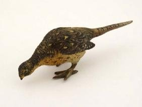 A cold painted bronze model of a hen pheasant. Late