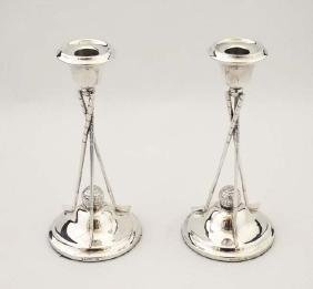 Golfing Interest : A pair of silver plate candle sticks