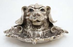A silver plate inkwell in the form of a dog's head with