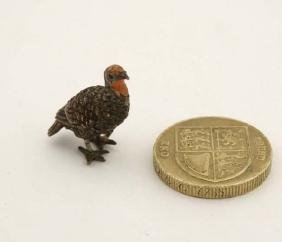 A cold painted miniature bronze model of an American