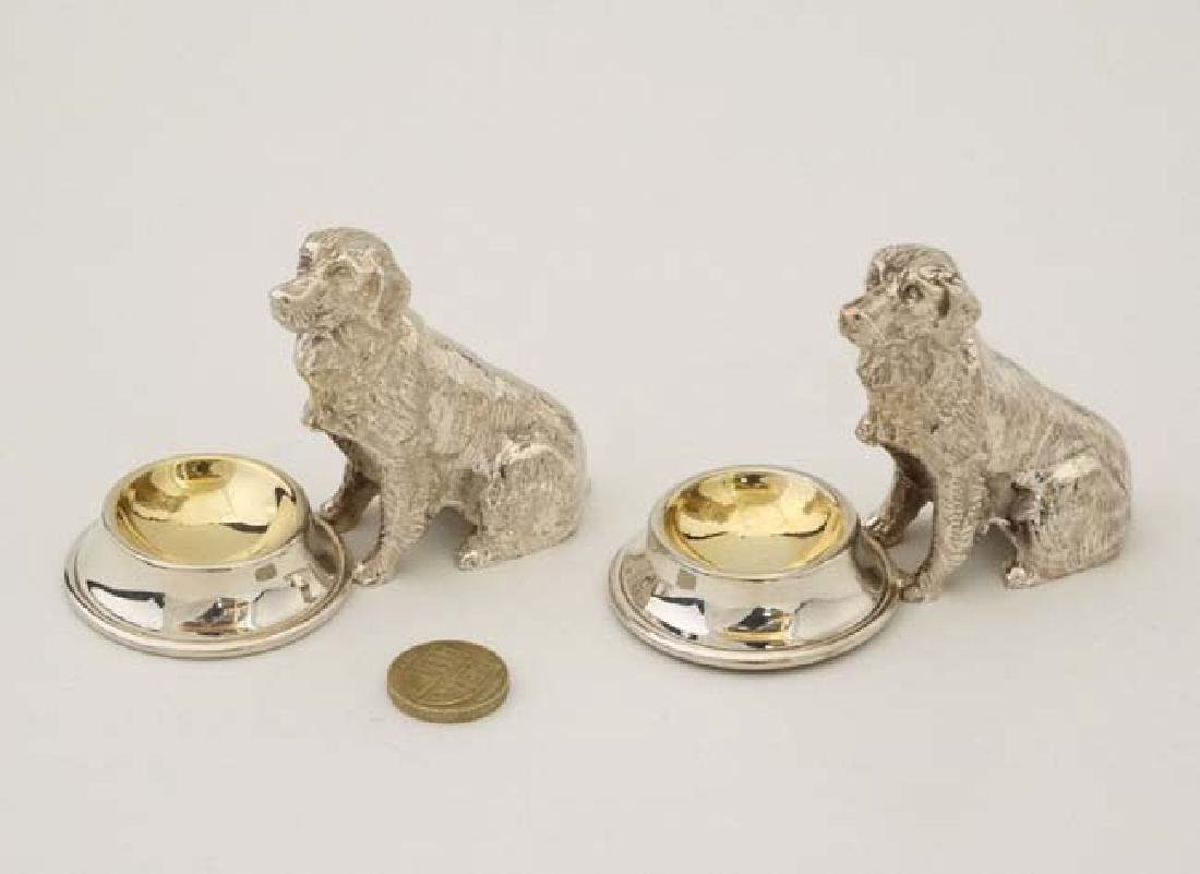 A pair of novelty silver plate table salts formed as