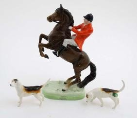 A Beswick figure group of a huntsman on a rearing bay