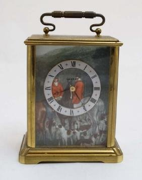 Hunting: A Swiss made brass cased carriage clock  ,