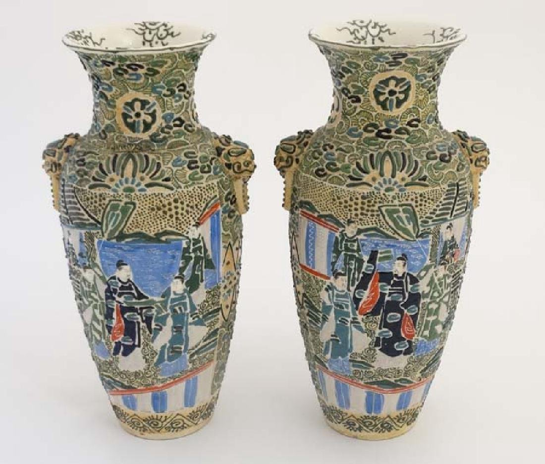 A pair of Japanese Satsuma Moriage twin handled vases,