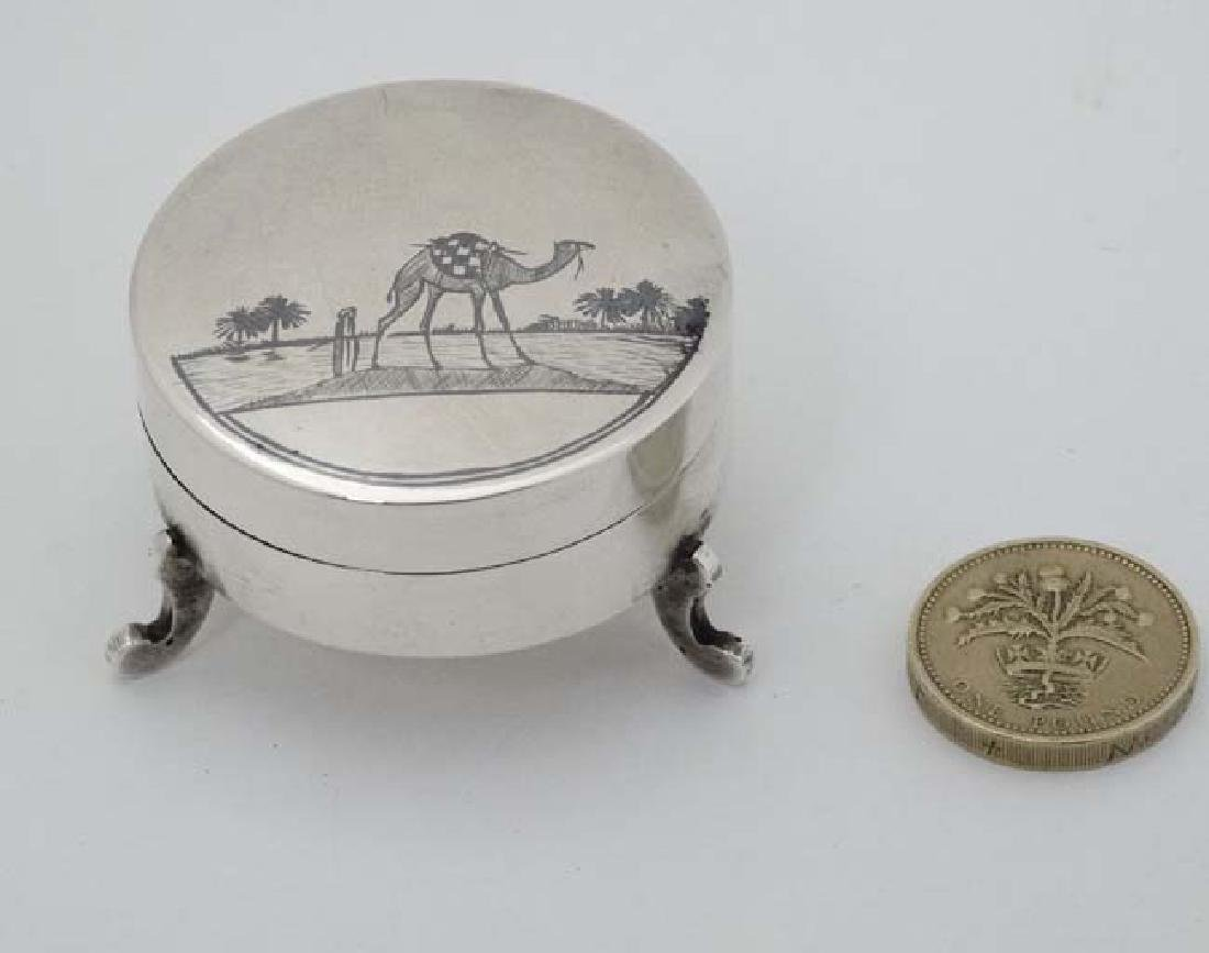 A white metal pot and cover on three shaped feet and - 2