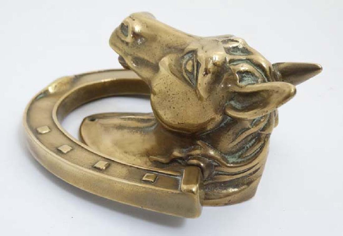 A cast brass door knocker in the form of a horses head - 4