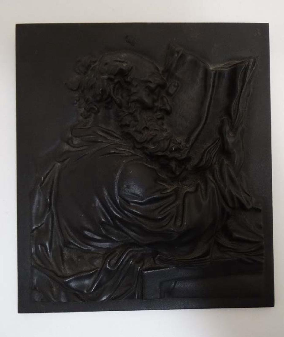 A 19thC cast iron relief plaque depicting a scholar and