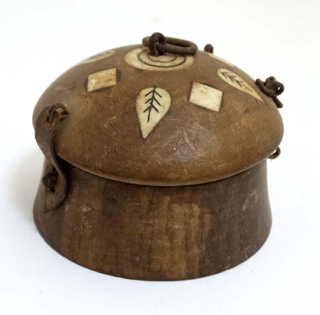 An old Indian clay? spice box with inked bone?