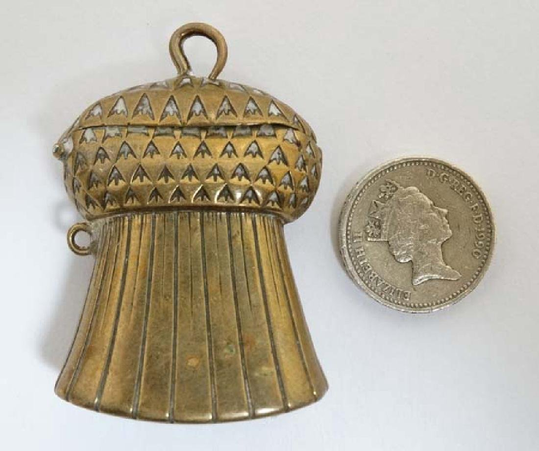 A brass vesta / match holder formed as a Scottish