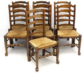 A set of 7 early 20thC oak ladder back dining chairs